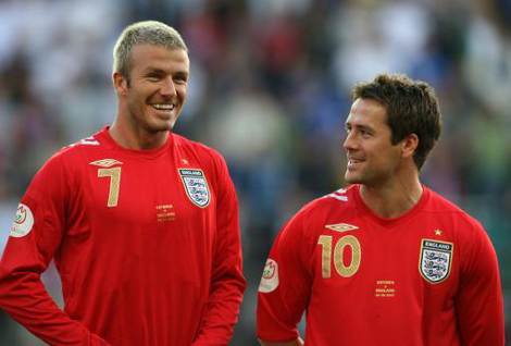 England's David Beckham and Michael Owen share a funny moment before the game